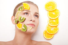 Smiling woman with fruit mask on her face isolated Royalty Free Stock Photography