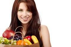 Smiling woman with fruits and vegetables. Royalty Free Stock Photo