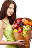 Smiling woman with fruits and vegetables. Stock Images