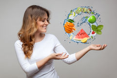 Smiling woman with fruits and water splash Royalty Free Stock Image