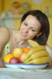 Smiling woman with fruits Royalty Free Stock Photo