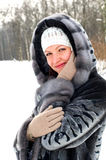 Smiling woman in fur coat Royalty Free Stock Photos