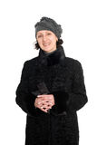 Smiling woman in a fur coat from broadtail Stock Image
