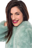 Smiling woman with fur coat. Stock Photography
