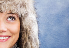 Smiling woman with fur hat Royalty Free Stock Photography