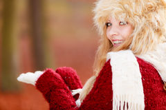 Smiling woman in fur winter hat with copyspace. Stock Photography