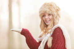 Smiling woman in fur winter hat with copyspace. Stock Image