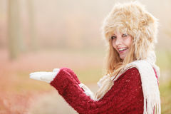 Smiling woman in fur winter hat with copyspace. Royalty Free Stock Images
