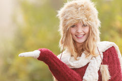 Smiling woman in fur winter hat with copyspace. Stock Images