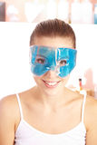 Smiling woman with gel mask Stock Images