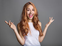 Smiling woman in gesture of asking Stock Image