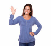 Smiling woman gesturing a greeting hand Stock Photography