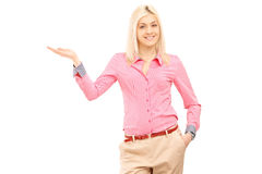 Smiling woman gesturing with hand Royalty Free Stock Photos