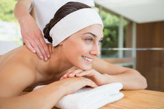 Smiling woman getting a back massage Stock Photo