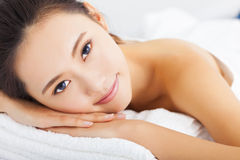 smiling woman getting spa treatment over white background Royalty Free Stock Images