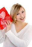 Smiling woman with a gift. Portrait of a smiling woman with a gift over white background Stock Photos