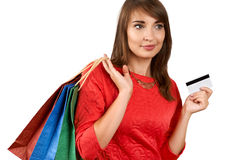 Smiling woman with a gift bag and a credit card Royalty Free Stock Photos