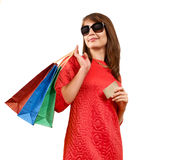 Smiling woman with a gift bag and a credit card Stock Photography