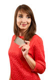 Smiling woman with a gift bag and a credit card Royalty Free Stock Photography