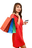 Smiling woman with a gift bag and a credit card Stock Image