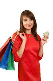 Smiling woman with a gift bag and a credit card Royalty Free Stock Image