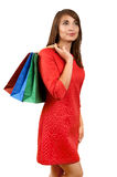 Smiling woman with a gift bag Stock Photos
