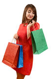 Smiling woman with a gift bag Royalty Free Stock Photos