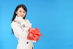 Smiling woman with a gift Stock Photo