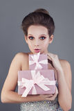 Smiling Woman and Gift Royalty Free Stock Image