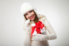 Smiling woman with gift box over light background Royalty Free Stock Photography