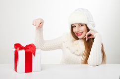Smiling woman with gift box over light background Stock Photos