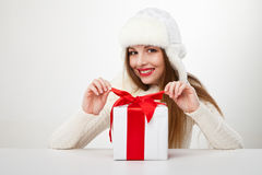 Smiling woman with gift box over light background Stock Photography