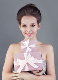 Smiling Woman and Gift Box Stock Images