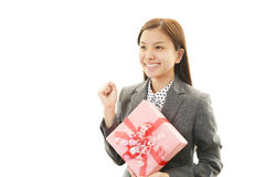 Smiling woman with a gift Stock Images