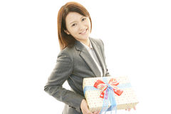 Smiling woman with a gift Stock Photography