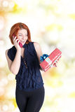 Smiling Woman with gifts boxs Royalty Free Stock Images