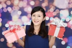 Smiling woman with gifts. The woman who smiles with presents Stock Photos