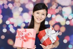 Smiling woman with gifts. The woman who smiles with presents Stock Images