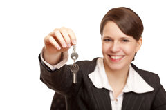 Smiling woman gives over house key Royalty Free Stock Image