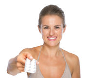 Smiling woman giving blistering package of pills Royalty Free Stock Images