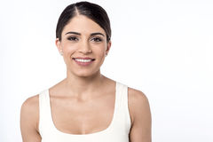 Smiling woman giving a casual look Stock Photography