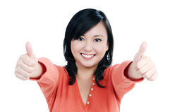 Smiling woman giving thumbs up sign Stock Photos