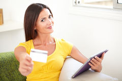 Smiling woman giving you a credit card Stock Images