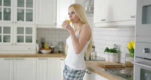 Smiling woman with glass of juice stock footage