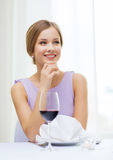 Smiling woman with glass of whine waiting for date Royalty Free Stock Images