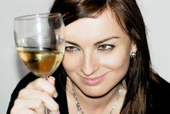 Smiling woman with glass of white wine Stock Photography