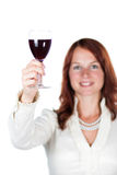 Smiling woman with glass of wine. Beautiful woman with a glass of a red wine. On white background royalty free stock images