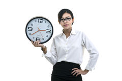 Smiling woman in glasses holding big clock Stock Image