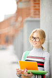 Smiling woman in glasses with open book royalty free stock image