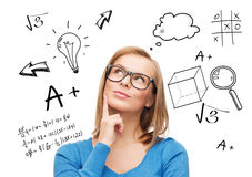 Smiling woman in glasses thinking or dreaming Stock Photo